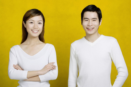 folding arms: Couple smiling at the camera.