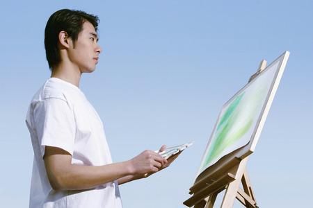 man painting: Man painting.