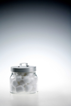 cotton ball: A full container of cotton ball
