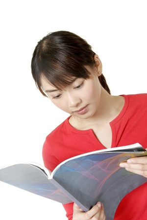 revision book: Woman reading book LANG_EVOIMAGES