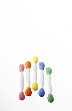 nicely: Five colourful applicators being arranged nicely