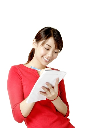 revision book: Woman writing on a notebook