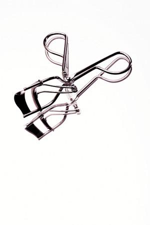 curler: A reflection of eyelash curler