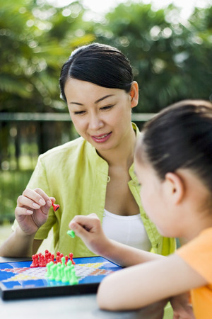 checkers: Mother and daughter playing chinese checkers
