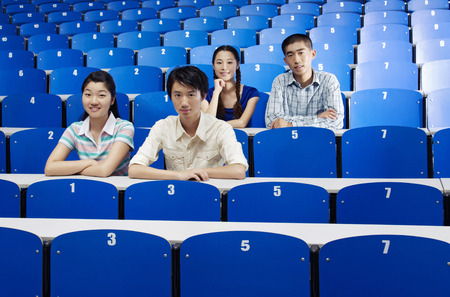 lecture theatre: College students smiling at the camera