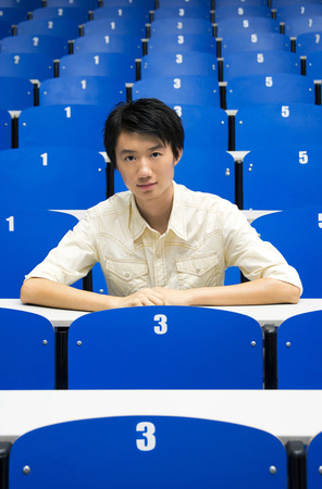 lecture theatre: Young man smiling at the camera