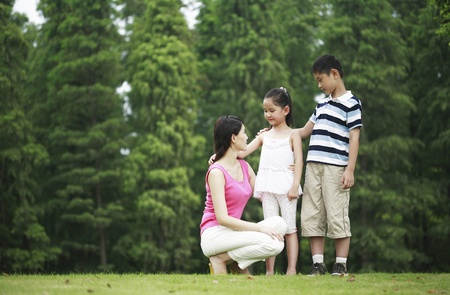 he   my sister: Mother and children in the park LANG_EVOIMAGES