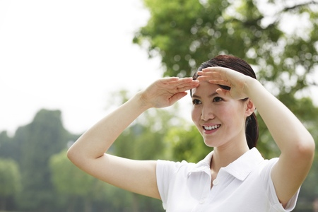 shielding: Woman shielding her face LANG_EVOIMAGES