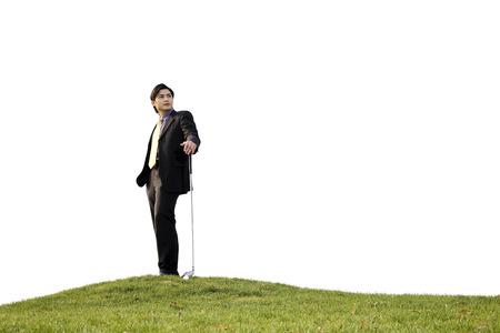 Businessman posing with golf club
