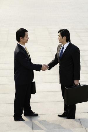 businessmen shaking hands: Two businessmen shaking hands