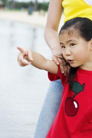 index finger: Girl pointing with her index finger