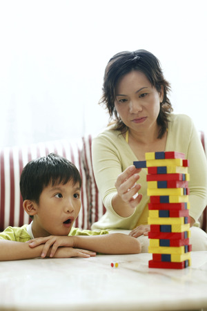wooden blocks: Mother and son playing wooden blocks