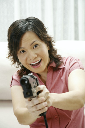 gun room: Mother holding toy gun