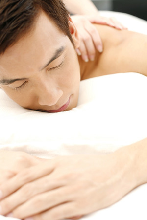 laying forward: Man getting a massage