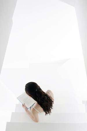 fair complexion: Woman reading on the staircase