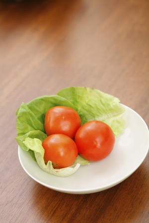 medium group: A plate of tomatoes and lettuce