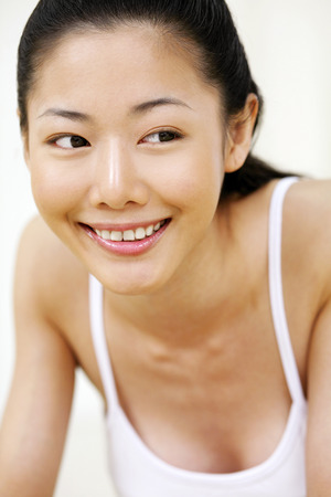 feminity: Woman smiling while looking away
