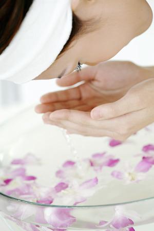 woman washing face: Woman washing face LANG_EVOIMAGES