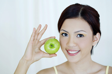 health conscious: Woman with green apple