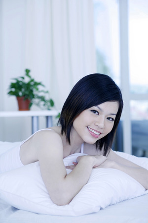 lying forward: Woman lying forward on the bed