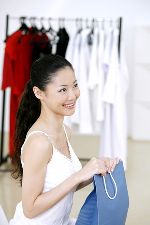 paper hanger: Woman sitting at the clothing store