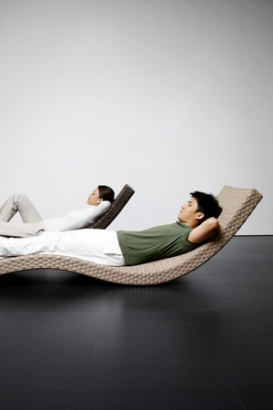 reclining chair: Man and woman relaxing on recliners