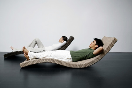 reclining chair: Man and woman relaxing on recliner