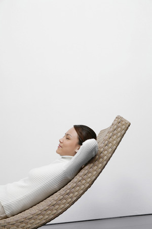 recliner: Woman relaxing on recliner