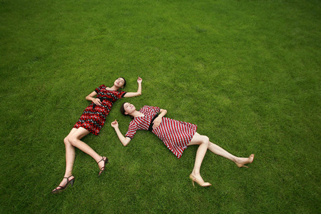 full grown: Women resting on the field