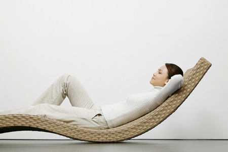 Woman relaxing on recliner