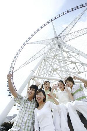 jubilating: Men and women jubilating, Ferris wheel in the background