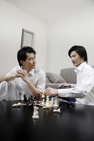 chess men: Men playing chess game