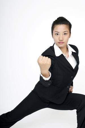 practising: Businesswoman practising martial arts