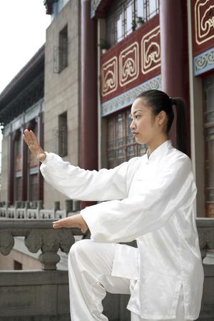 practising: Woman practising martial arts