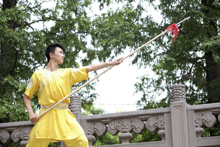 he is a traditional: Man practising martial arts with chinese spear LANG_EVOIMAGES