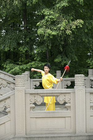 he is a traditional: Man posing with chinese spear