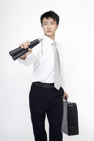 nunchaku: Businessman with briefcase and nunchaku