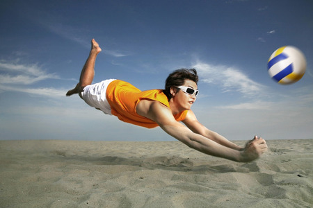Man diving to hit volleyball Stock Photo - 39005055