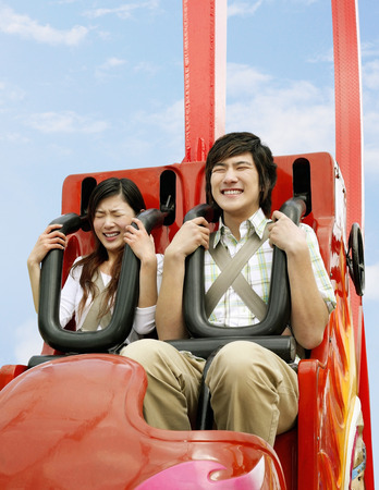 roller: Man and woman on a roller coaster ride LANG_EVOIMAGES