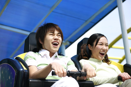 roller: Man and woman on a rollercoaster ride LANG_EVOIMAGES