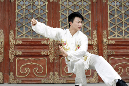 he is a traditional: Man practising martial arts