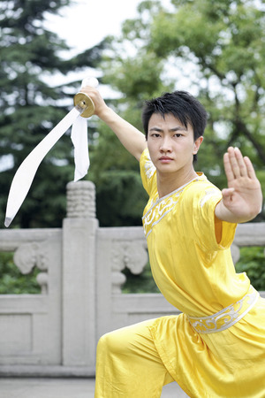 Man practising martial arts with a sword Stock Photo