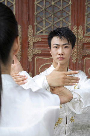 he is a traditional: Man and woman practising martial arts LANG_EVOIMAGES