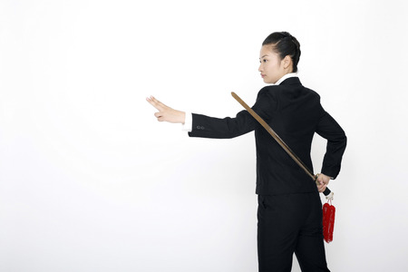 practising: Businesswoman practising martial arts with a sword