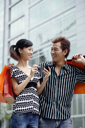 pocket pc: Man and woman with shopping bags