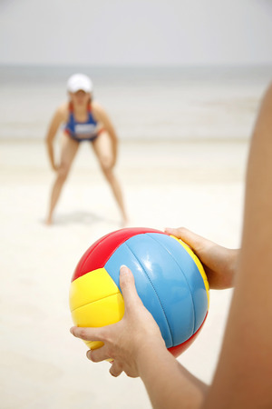 two persons only: Women playing beach volleyball LANG_EVOIMAGES