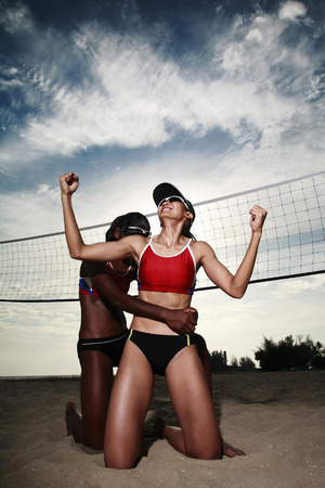 jubilating: Women jubilating after winning the volleyball game LANG_EVOIMAGES
