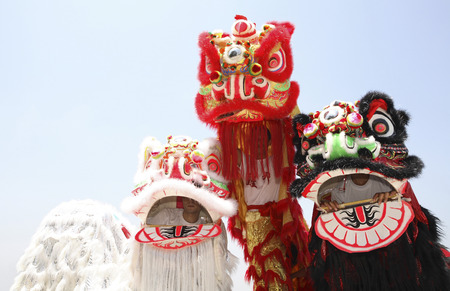 performers: Performers in three different lion costumes
