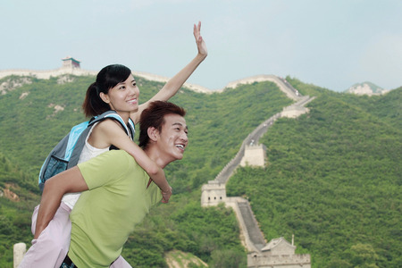 man carrying woman: Man carrying woman on his back LANG_EVOIMAGES