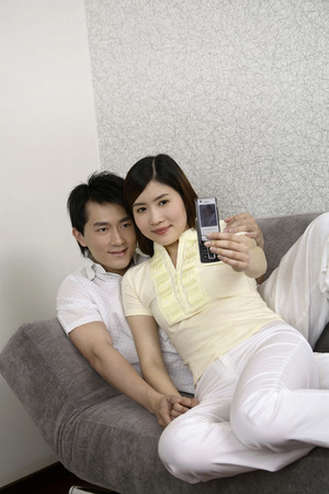 two persons only: Man and woman taking picture using mobile phone LANG_EVOIMAGES